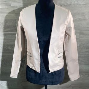 Have tan half jacket with zipper pockets